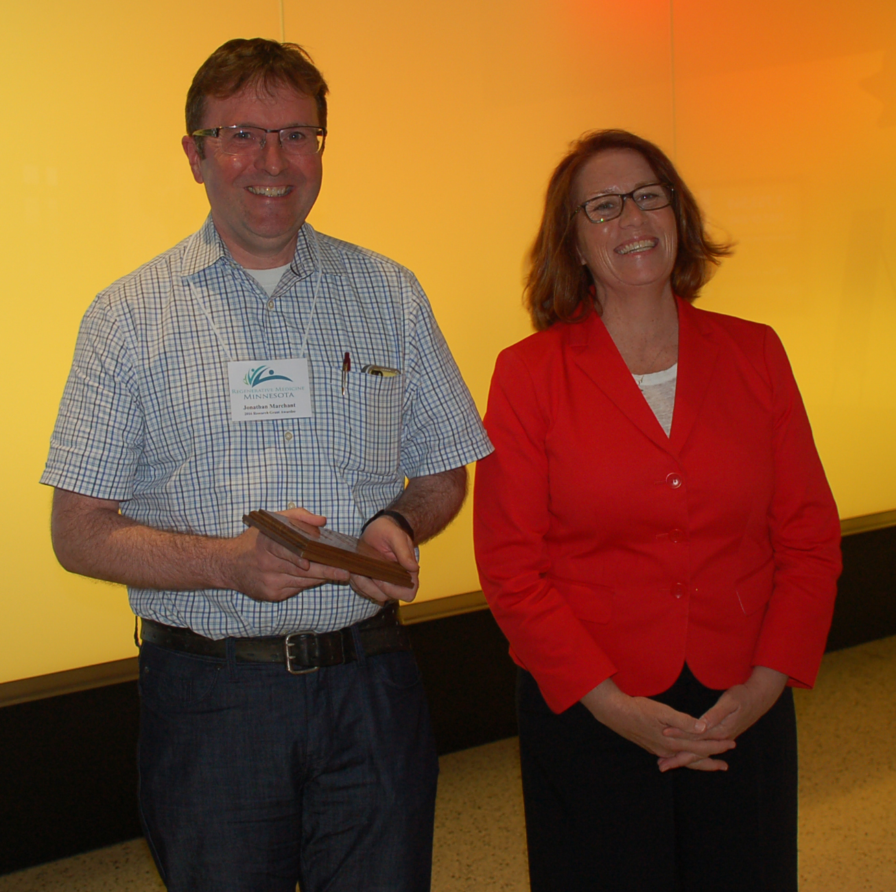 Dr. Jonathan Marchant, seen here with Rep. Erin Murphy, received a Discovery Science Research grant to study a therapy to reverse cell damage caused by Parkinson's disease.