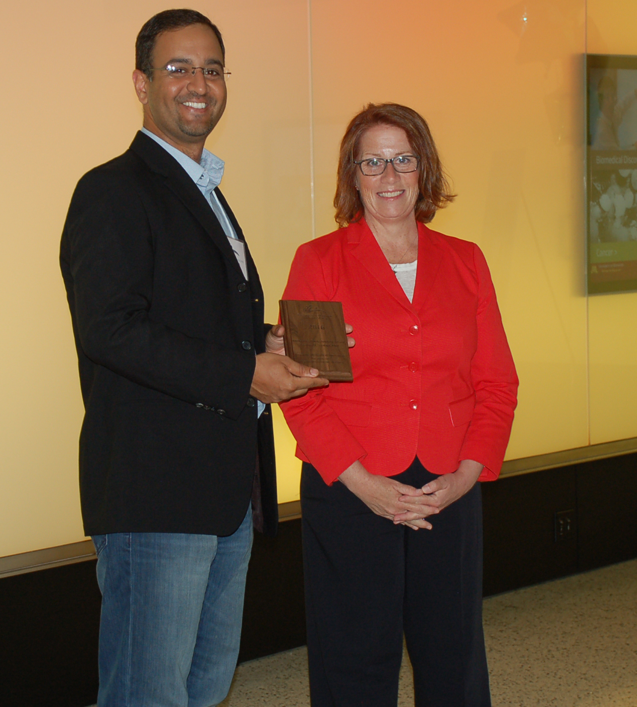 Dr. Zeeshan Syedain, seen here with Rep. Erin Murphy, received a Biobusiness/Biotechnology grant to develop a way to culture living, growing arterial grafts for children who currently require multiple open-heart surgeries when they outgrow their artificial grafts.